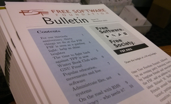 Picture of the Bulletin with boxes of envelopes in the background