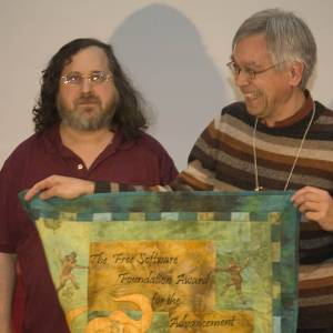 Richard Stallman presenting the Free Software Foundation Award for Advancement of Free Software to Wietse Venema, creator of Postfix.