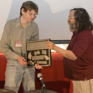 Richard Stallman presenting the Free Software Foundation Award for Projects of Social Benefit to Mike Linksvayer, Vice President of Creative Commons.