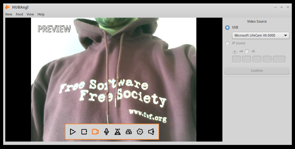An image of the HUBAngl video streaming interface. The words 'PREVIEW' are in the top left corner, and a menu bar of icons is at the center-bottom of the screen. Dominating the image is the torso of a person wearing a maroon sweatshirt that reads 'Free Software Free Society.'