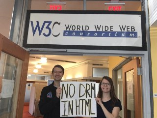 Two activists at the Cambridge W3C office.