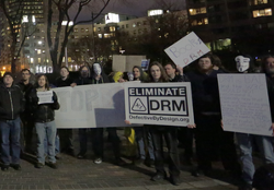 Activists at a protest against DRM.