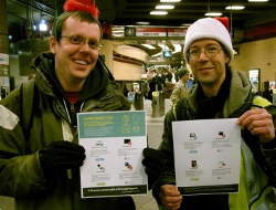 Santa's helpers (activists) about to distribute the Giving Guide to commuters