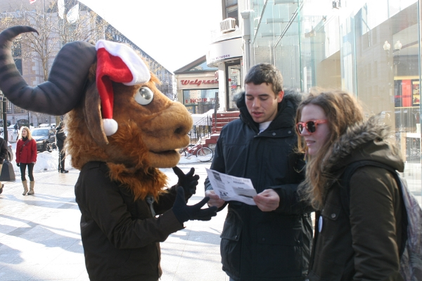 An activist sharing the Giving Guide at a Giveaway.