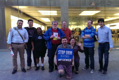 Activists at an Apple store on the 2015 Day Against DRM.
