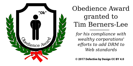 A plaque, surrounded by laurels, featuring the words 'Obedience Award' and a stick figure saying 'Ok'.