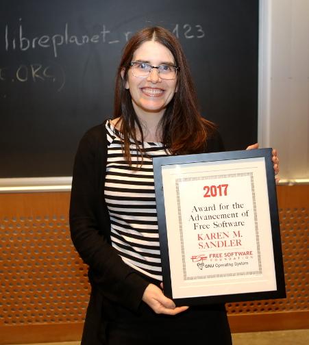 Karen Sandler with award