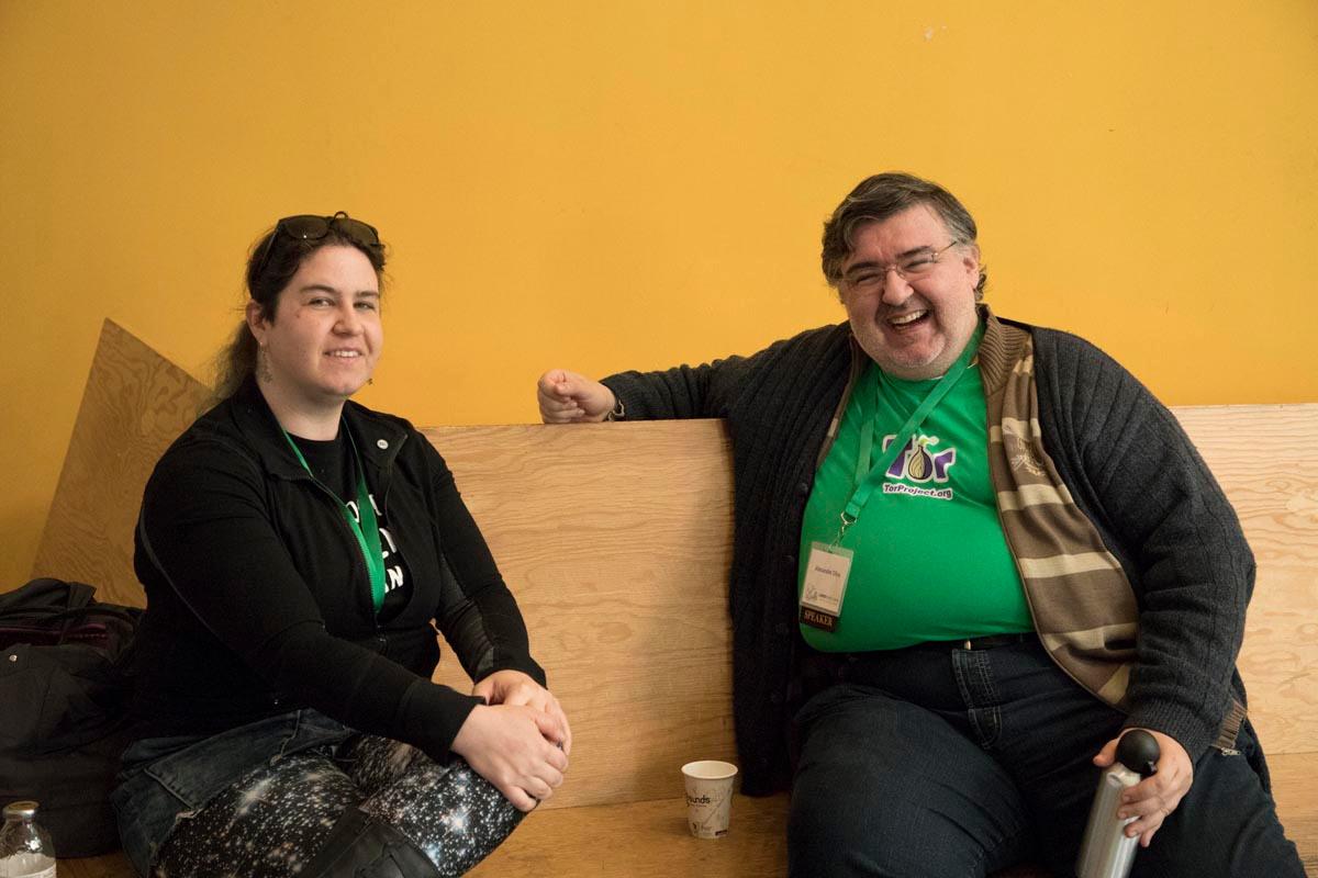 FSF board member Kat Walsh and speaker Alexandre Oliva posing on a bench