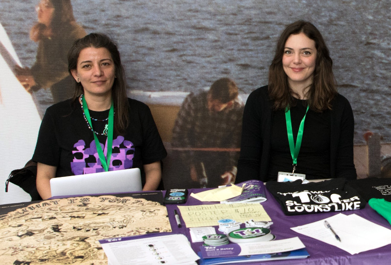 Isabela Bagueros poses with a colleague at the Tor Project table at LibrePlanet 2019.