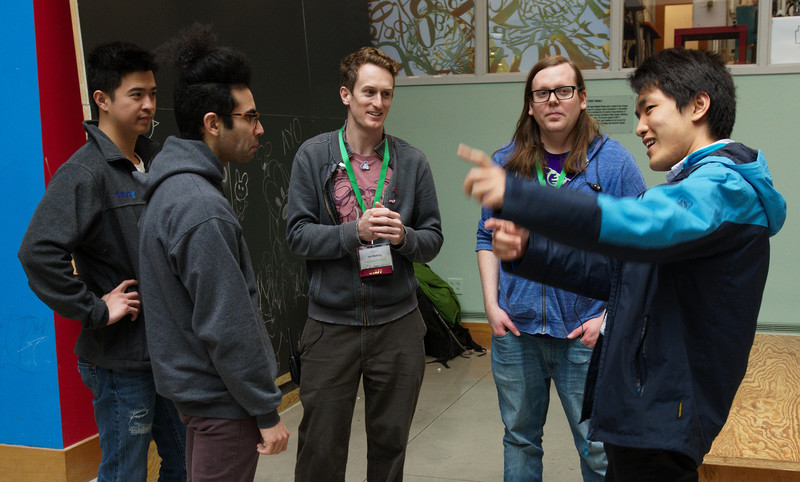 Tech team members Ian Kelling and Andrew Engelbrecht chat with friends at the LibrePlanet 2019 conference.