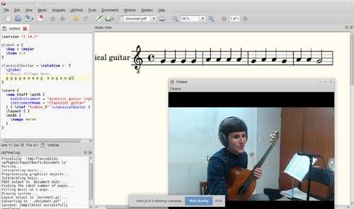 Article author and teacher Devin Ulibarri is shown holding a guitar and wearing headphones in a screenshot from his Jitsi Meet teaching session with a student